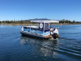 Mal's BBQ Boat drives along Wagonga Inlet in narooma