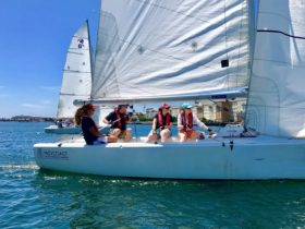 Force 24 keelboat sailing on Newcastle Harbour. A sunfilled day of enjoyment on the water awaits!