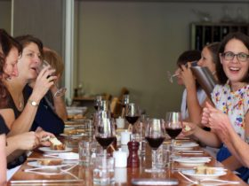 Group of people dining and laughing