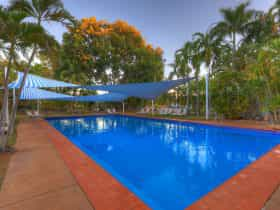 shaded pool amongst lush trees