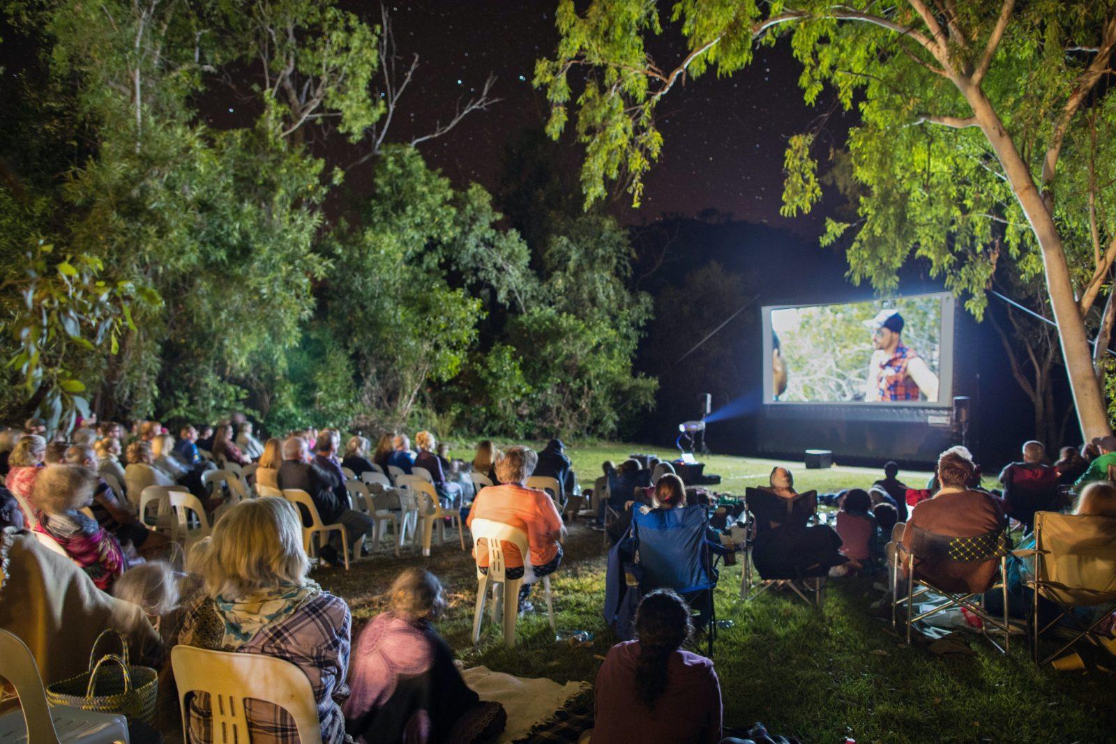 People watching films at night