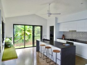 Galley kitchen with island bench and bench seat