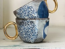 Patterened blue cups with a gold handle
