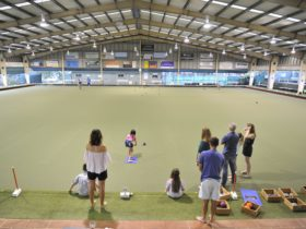 Family and freinds enjoying barefoot bowls