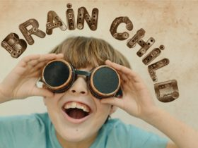 child with goggles and the text brain child