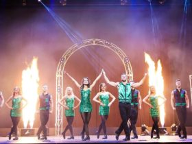 Celtic dancers dancing next to columns of flame