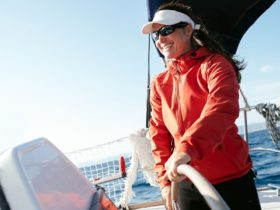 A woman at the helm of a sailing boat