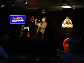 Comedian Peter James performing at Laughing Heart Comedy