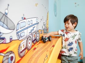 An excited boy tests his LEGO car in the 'On The Move' interactive exhibition.
