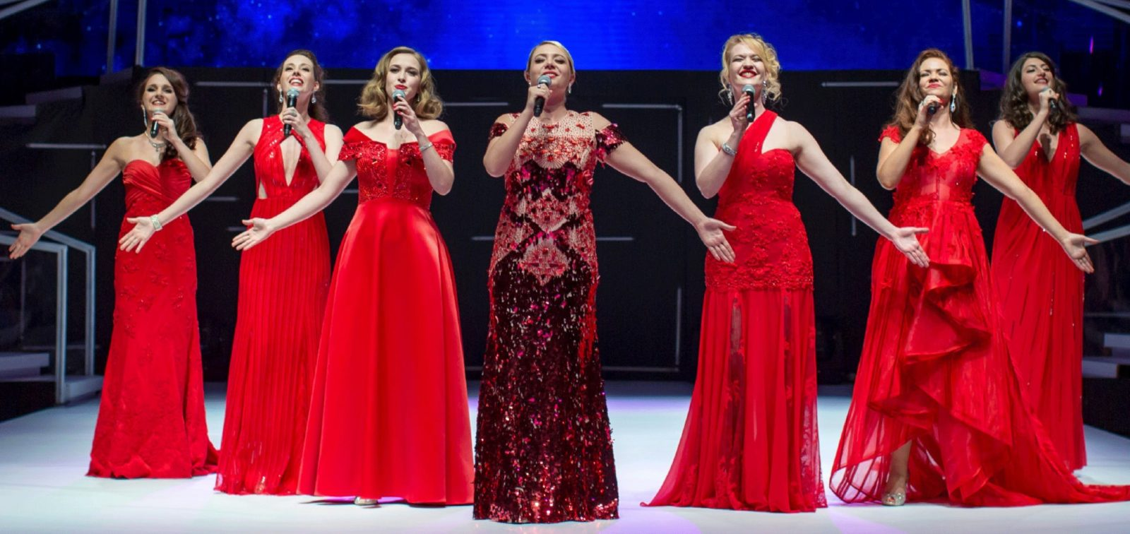 The 7 Sopranos performing in their signature red gowns