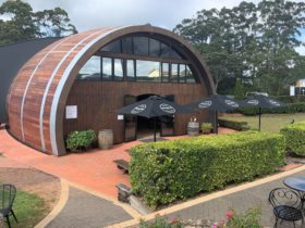 Exterior photos of The Barrel at Clouds Vineyard, a wine barrel shaped structure for wine tasting