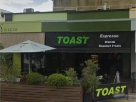 photo showing the faced of Toast Espresso bar with its outdoor seating on the street side