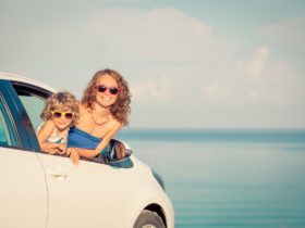 Family in car by the beach
