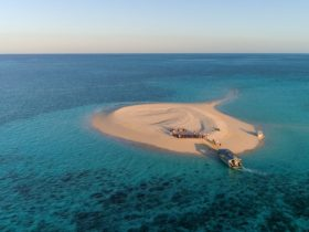 Sip sundowners and feel the sand beneath your feet on isolated sand cays and uninhabited islands