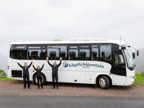 Mystic Mountain Tours team with bus
