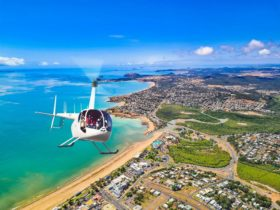 Photo of helicopter flying over Capricorn Coast