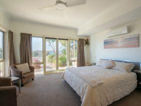 Searenity Holiday Apartment, Emu Bay, Kangaroo Island - spacious bedroom with sea views.