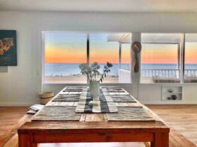 Open plan living and dining sea view