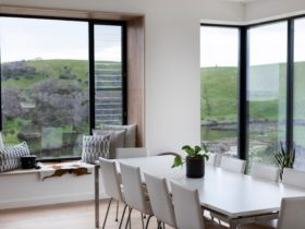 A dining space with a stunning view of Middle River and Snelling Beach