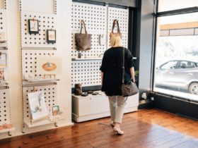Tanunda Shopping Destination customer looking at leather goods