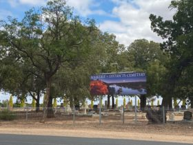 Road view of Waik Cemetery Strangman Rd signage