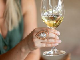 Woman holding glass of wine to celebrate Chardonnay May