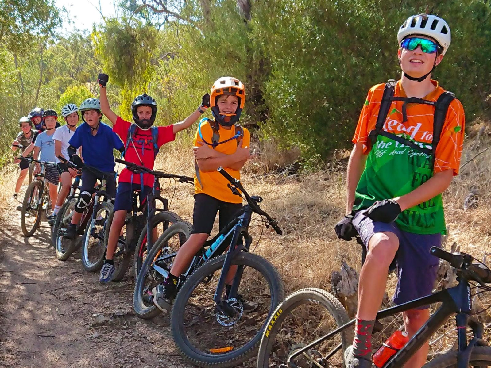A group of mountain bikers on a trail