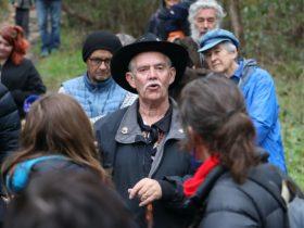 Elder Ivan Copley talking to a group of people