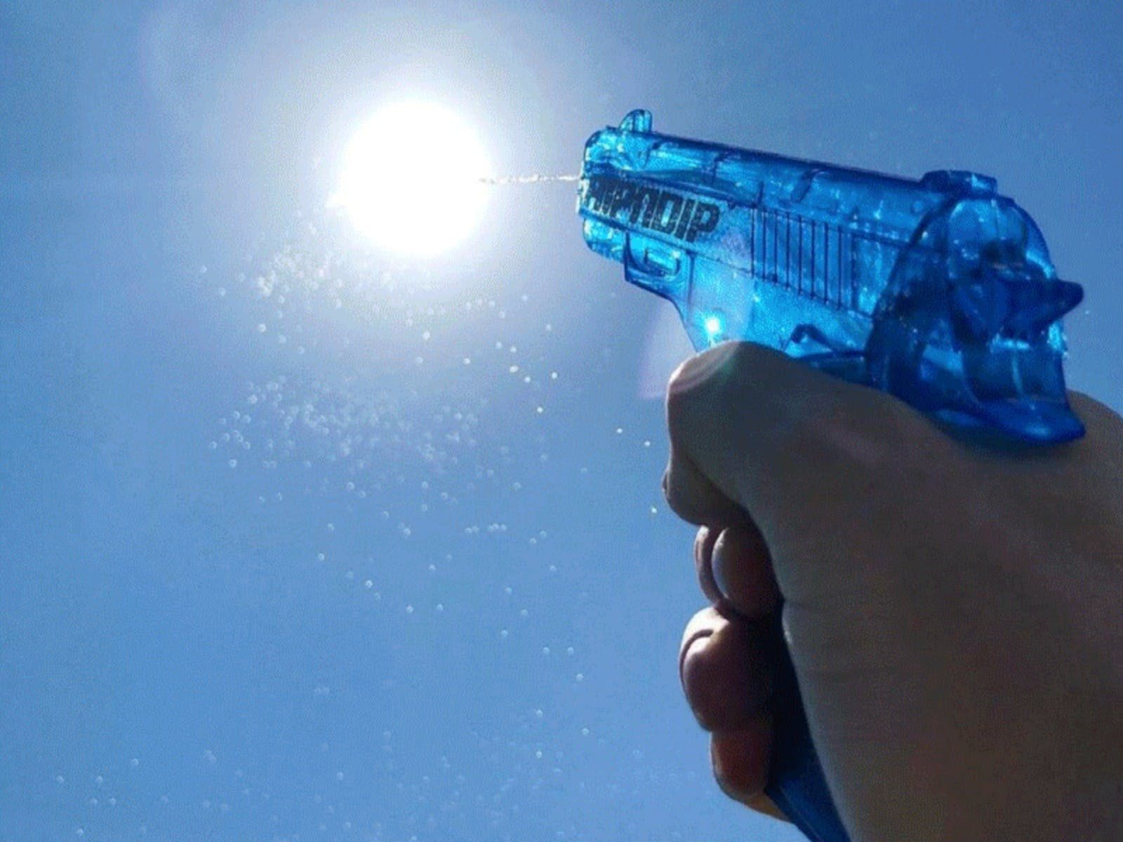 Water Pistol pointing to sky