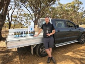 Winemaker Rob Mack with Aphelion wines on the tray of a ute