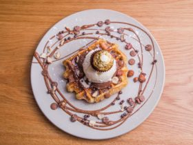 Ferrero Waffle served with pure melted chocolate, maple syrup and French Vanilla Ice Cream.