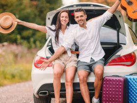 Happy couple in their hire car on their way to their destination