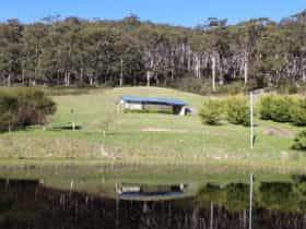 Cherryview Studio from across the water with forest behind