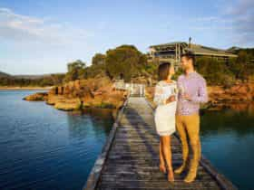 Enjoying a drink and views from the Lodge's jetty