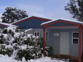 A dusting of snow around Studio Apertments Three and Four, at Highland Cabins and Cottages, Bronte P