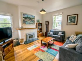 Two lounge-sitting rooms with comfy couches and smart TVs
