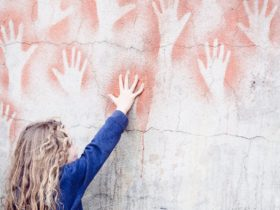 Ochre hand prints and girl