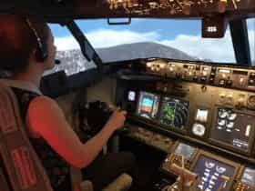 girl in flight simulator touring Hobart