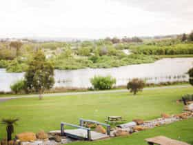View from restaurant of lawns, creek and lake.