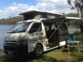 Campervan shown free camping, it's an option in many parts of Tasmania.