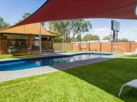 Our Shaded outdoor pool area is the place to be in Summer