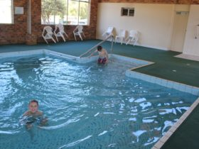 Kids swimming in indoor heated swimming pool
