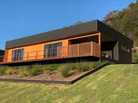 Blueview Apartment perched on a grassy hill.