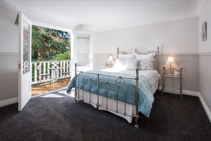 Stables main bedroom with double French doors & private deck