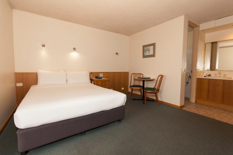 Queen size bed, table and chairs, desk, small refrigerator and tea coffee making facilities.