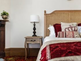 Queen bed and bedside table made up in style