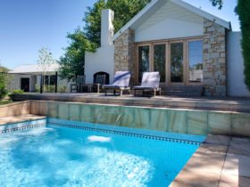 Pool house with outdoor pool and hot tub