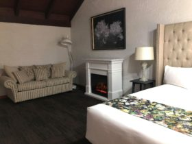 Sussex King Suite with fireplace and sofa