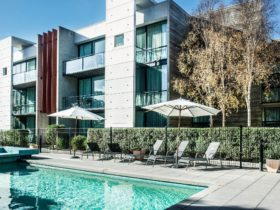 Relax by the outdoor swimming pool, heated spa and BBQ area.