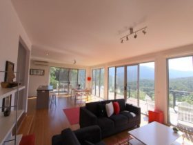 OPen plan living/dining/kitchen area with views